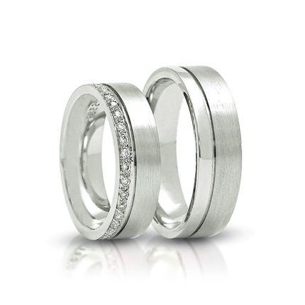 Обручальные кольца из платины с бриллиантами на заказ
