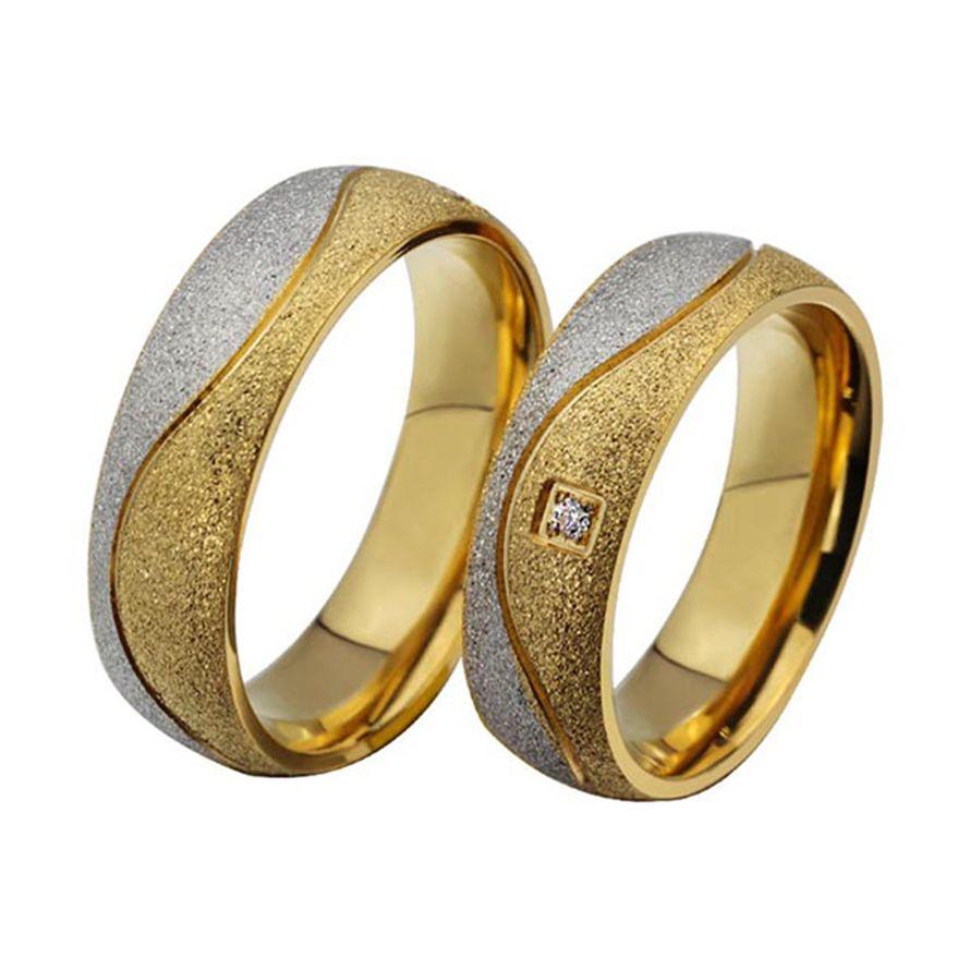 Обручальные кольца из комбинированного золота с бриллиантами на заказ