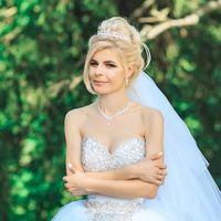 Свадебный образ с высоким пучком и фатой