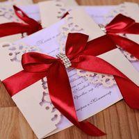 Резные приглашения в цвете айвори с красной лентой и брошью. Гамма любая