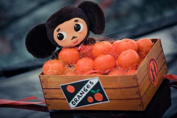 В деревяннм ящике, наполненным мандаринами, сидит Чебурашка - фото 2345944 ОЛЬКА1209