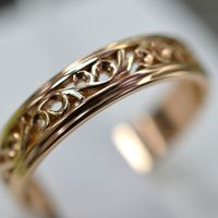 Ажурное обручальное кольцо из красного золота 585 пробы