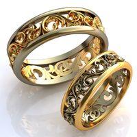 Обручальные кольца из белого и желтого золота с узорами