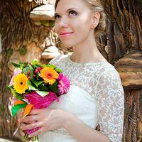 Образ невесты с букетом из гербер