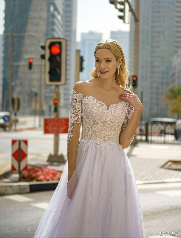 Платье: 125 Возможные цвета: белый Цена: 19900 Вариант покупки: под заказ Оплата: 100% предоплата  Срок исполнения от 1-1,5 месяцев! - фото 17035002 Свадебный салон Feorina