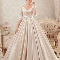 Свадебное платье LAURA  Цвет в наличии: Молочный - Капучино  Атласное свадебное платье LAURA ультрамодного на сегодня цвета капучино создаст из любой невесты сказочную принцессу!  У платья роскошная пышная юбка с кармашками, переходящая в небольшой шлейф,