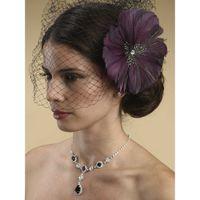 Экзотичное украшение в прическу в виде цветка, выполнено из перьев павлина, с крупным австрийским кристаллом